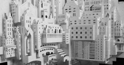 l'architecture papier est un art fascinant : une feuille de papier est pliée, découpée intérieurement pour représenter en relief un bâtiment.